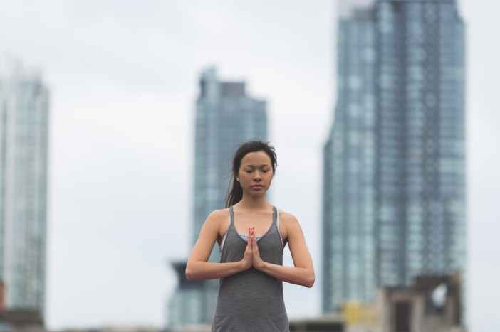 shallow focus photography of woman doing yoga
